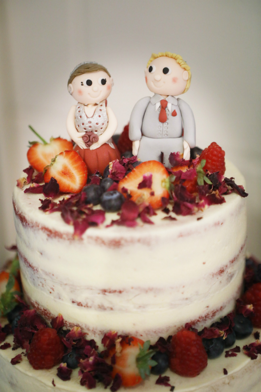 Sugar bride in red wedding dress & groom in 3 piece suit