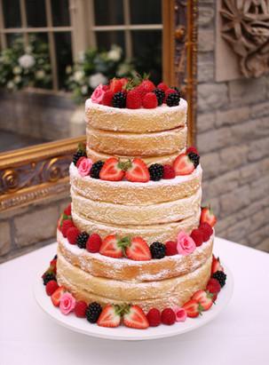 3 tier naked wedding cake with fresh fruit & sugar flowers