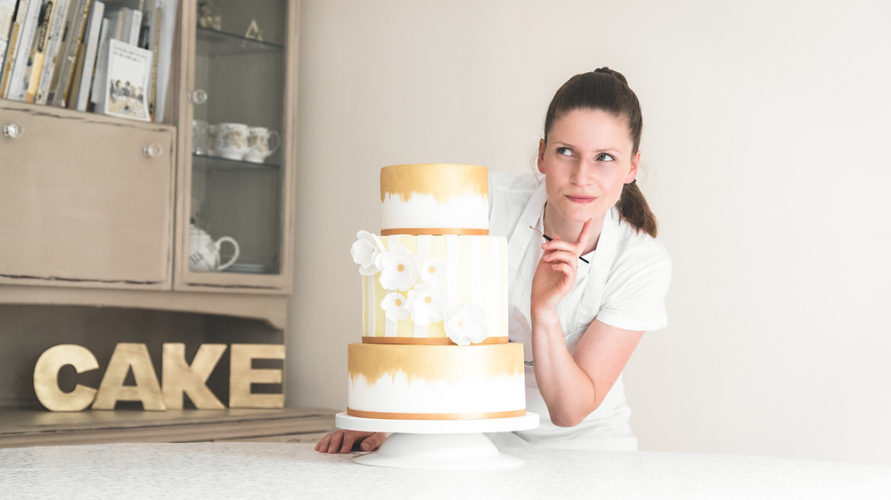 Ali Walsh with wedding cake