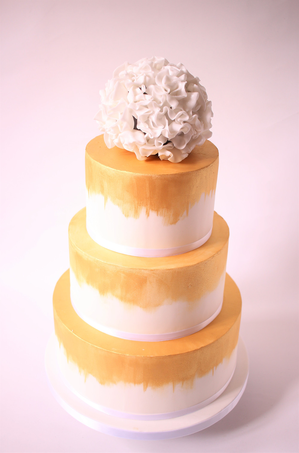 Wedding cake with edible flower ball on top