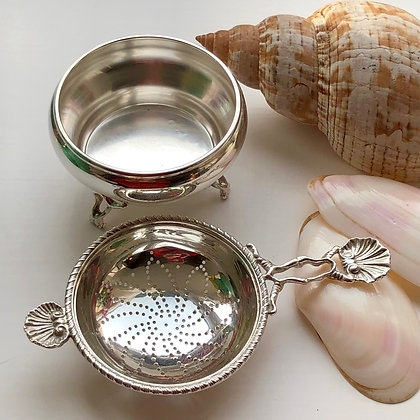 A Sterling Silver Tea Strainer London 1963 With Shell Decoration.