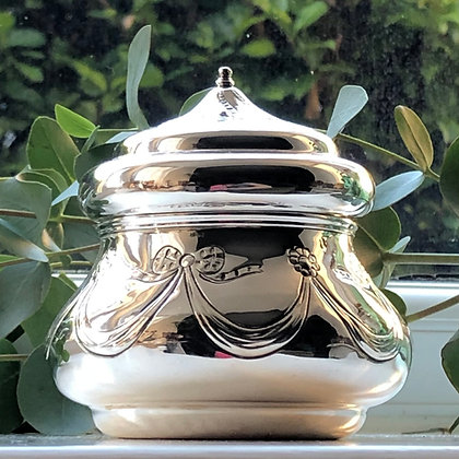 A Antique Sterling Silver Tea Caddy With A Swag And Bow Decoration London 1902.
