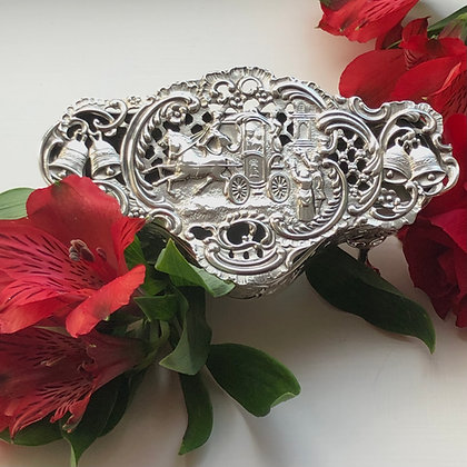 A Sterling Silver Potpourri Box With A Embossed Wedding Scene.