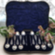A Set Of Twelve Silver Tea Spoons With Matching Tongs With A Pierced Design.
