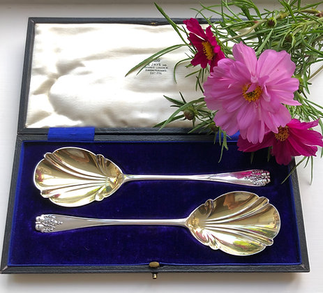 A Pair Of Silver Gilt Serving Spoons With A Bow Decoration London 1912.