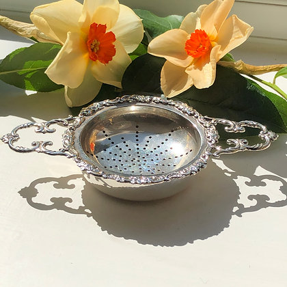A Silver Tea Strainer On A Matching Stand Made In London By Richard Comyns