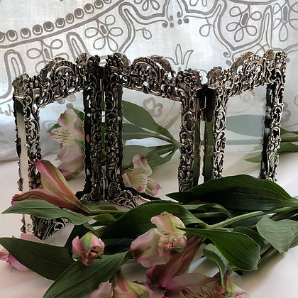 A Victorian Silver Triple Picture Frame With A Pierced Design By William Comyns.