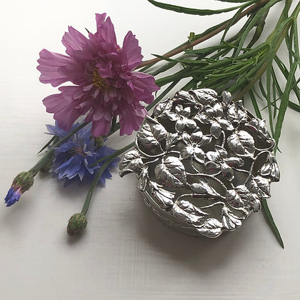 A William Comyns Silver Potpourri Box With A Pierced Leaf And Flower Lid.