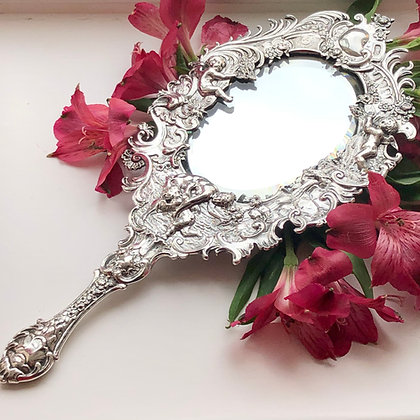 A Antique Victorian Silver Hand Mirror Circa 1900 Decorated With Cherubs.