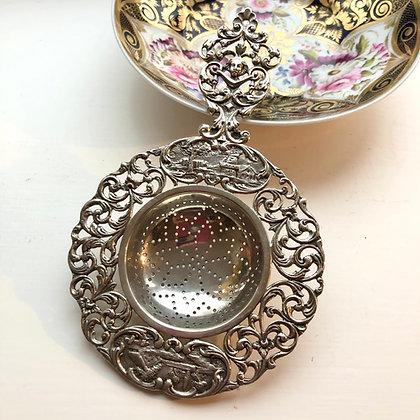 A Dutch Silver Tea Strainer Circa 1900 Decorated With Country Scenes.
