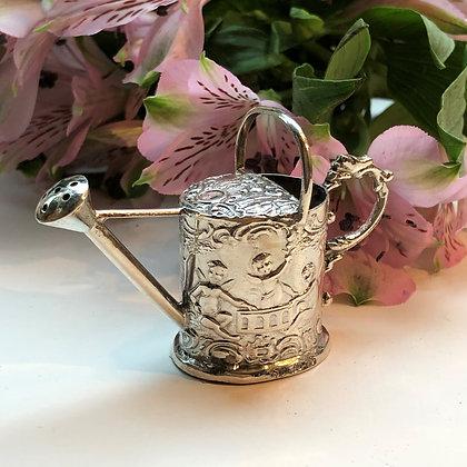 A Silver Miniature Watering Can Decorated With A Pretty Cherub Scene.