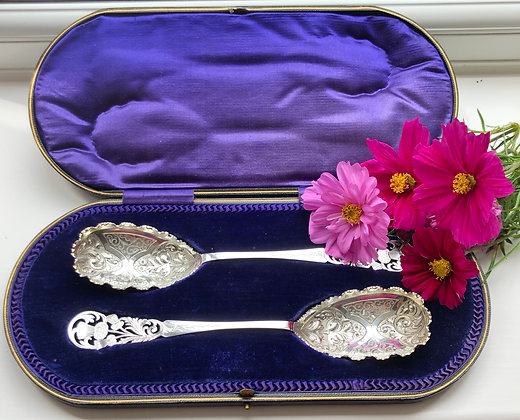 A Pair Of Silver Pierced And Engraved Serving Spoon With Thistle Decoration.