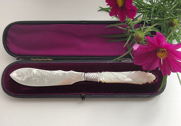 A Silver And Pearl Handled Butter Knife London 1884 With A Engraved Blade.