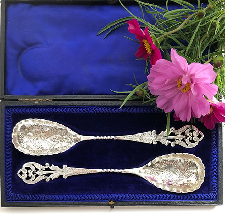 A Pair Of Silver Serving Spoons With An Embossed And Pierced Decoration.