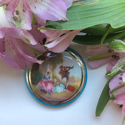 A Guilloché Enamel And Silver Compact Painted With A Romantic Scene