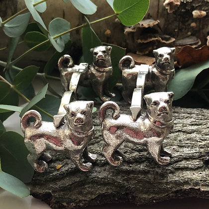 A Pair Of Antique Silver Plated Pug Dog Knife Rests Circa 1900.