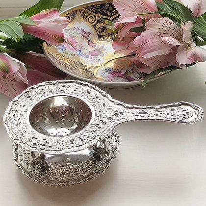 A Antique German Silver Tea Strainer On Its Original Stand Circa 1900.