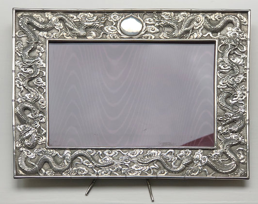 A Chinese Silver Picture Frame With Dragon Design.
