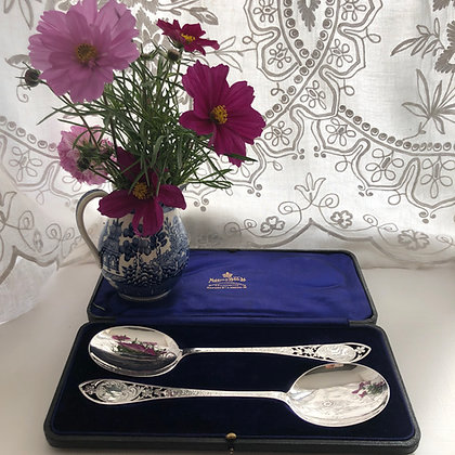 A Pair Of Silver Serving Spoons Plain With A Engraved And pierced Handle.