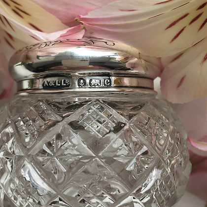 A Pretty Little Silver Topped Jar With A Winged Cherub Design.
