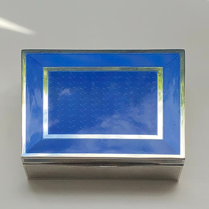 An art deco guilloché blue enamel and silver rectangular Box.