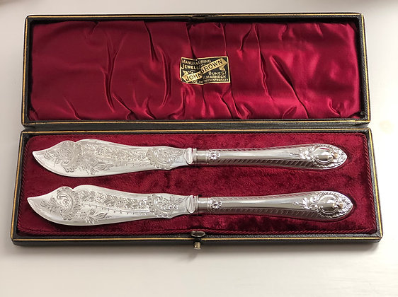 A Pair Of Silver Plated Butter Knives Circa 1900 With Engraved Blades.