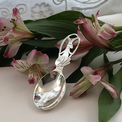 A Art Deco Silver Child's Feeding Spoon With A Rabbit Design On The Handle.