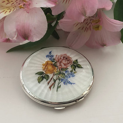 A Silver And Enamel Ladies Compact Painted With Flowers Birmingham 1967.