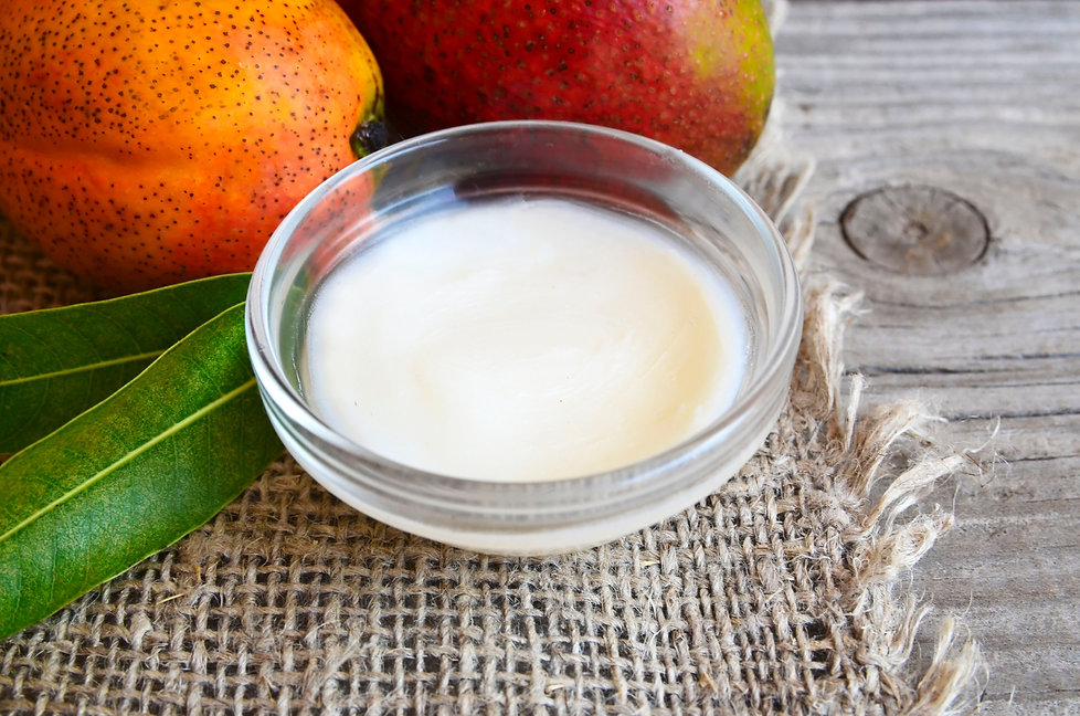 Mango body butter in a glass bowl and fr