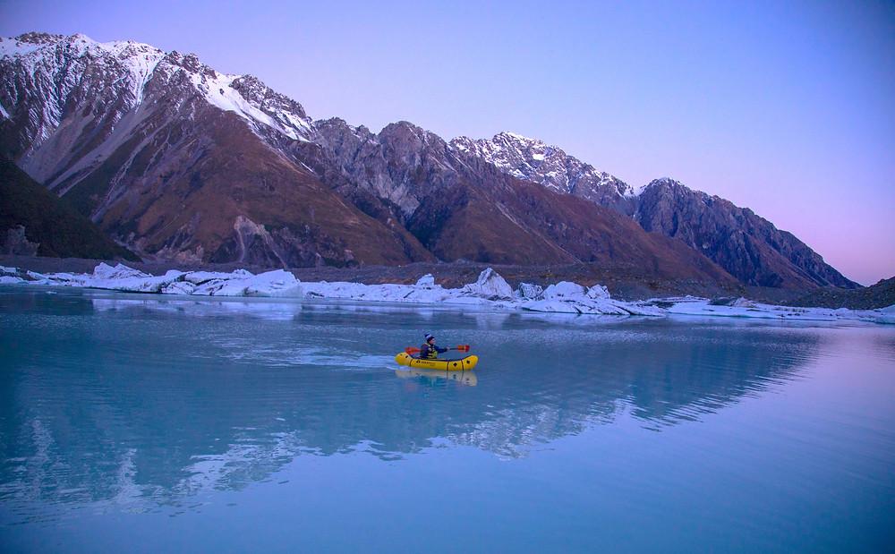 Pack-rafting Tasman Lake At Sunset With Icebergs Mount Cook National Park
