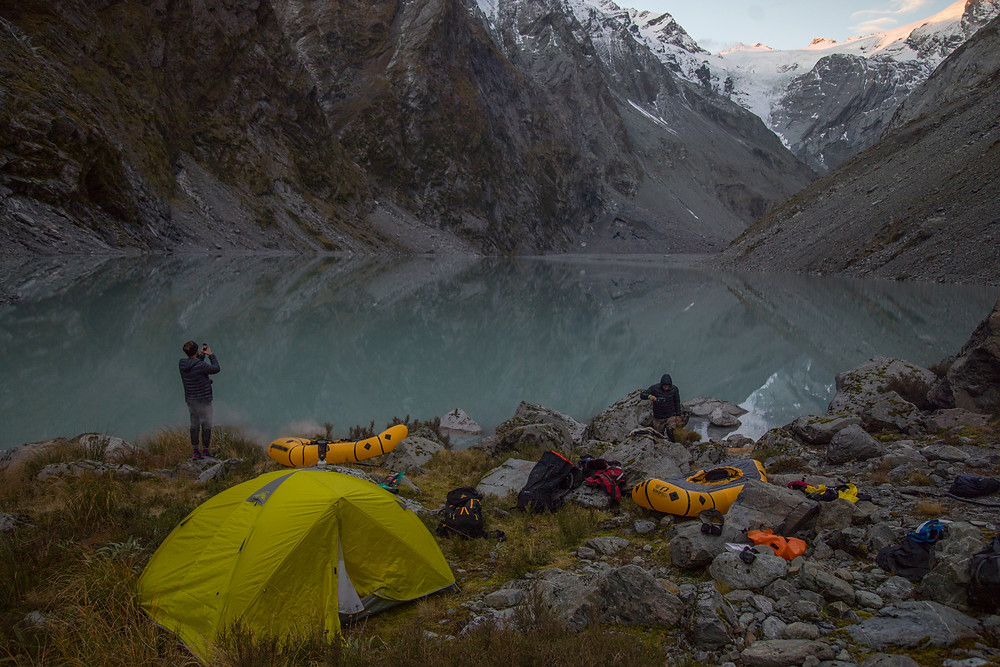 Looking over the source of the Butler River, an ice lake and a kea the night before packrafting the river.