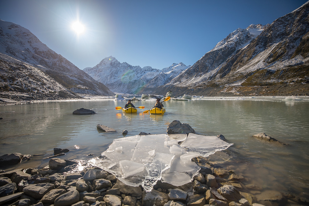 Two Pack-rafters Exploring Icebergs On Hooker Lake