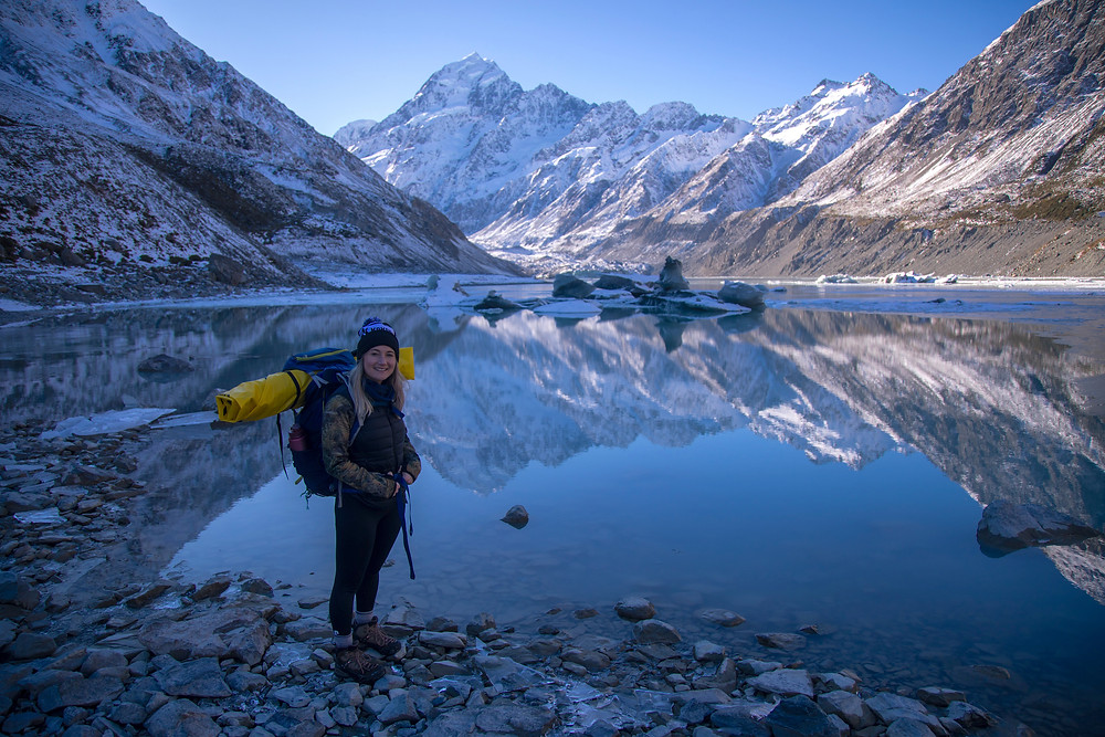 Female Hiker Standing At The Shore Of Hooker Lake Mount Cook