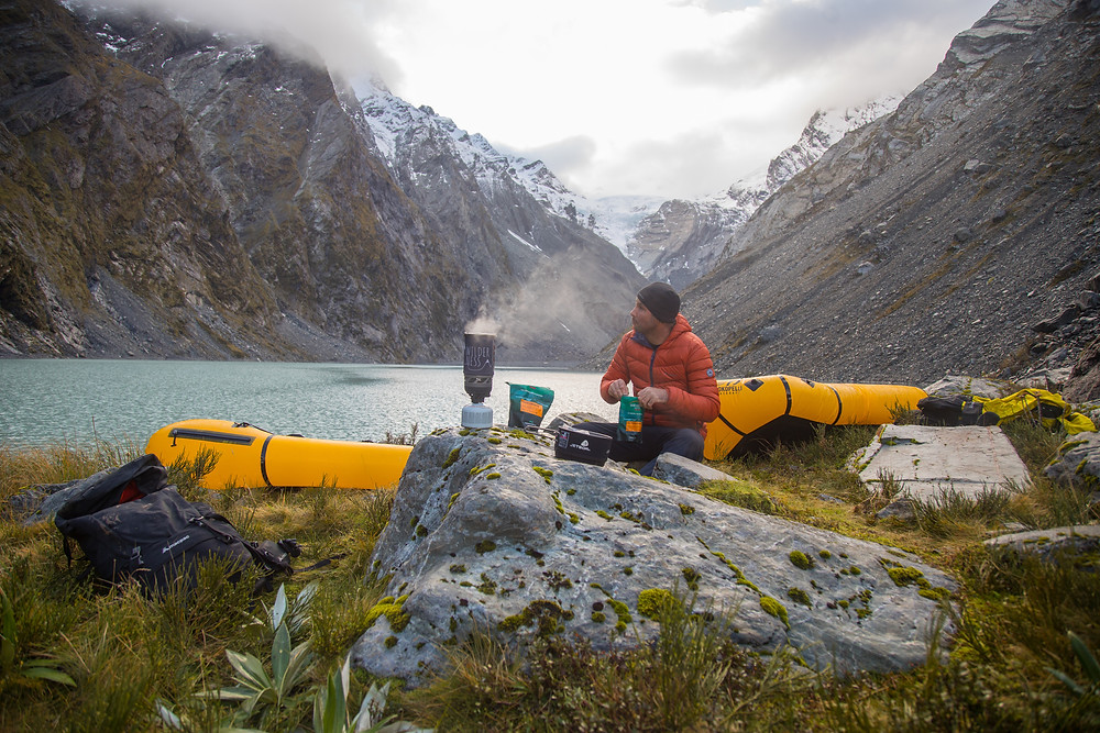 Packrafting Looking over the source of the Butler River, an ice lake and a kea the night before packrafting the river.
