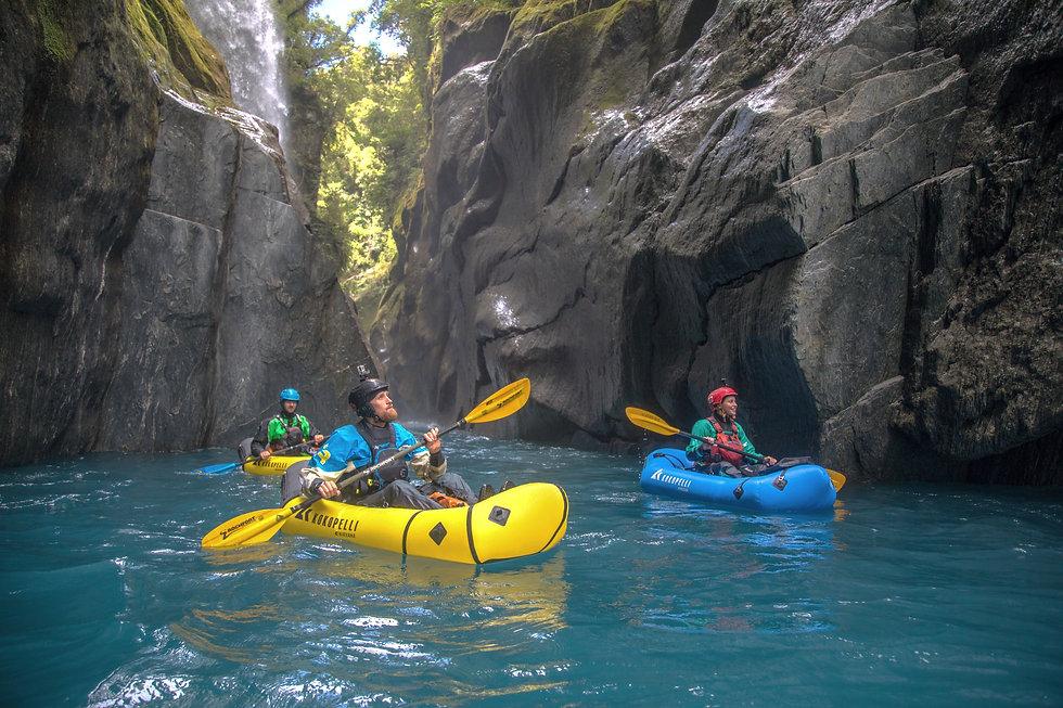 Pack raft New Zealand paddling the Hokitika river.