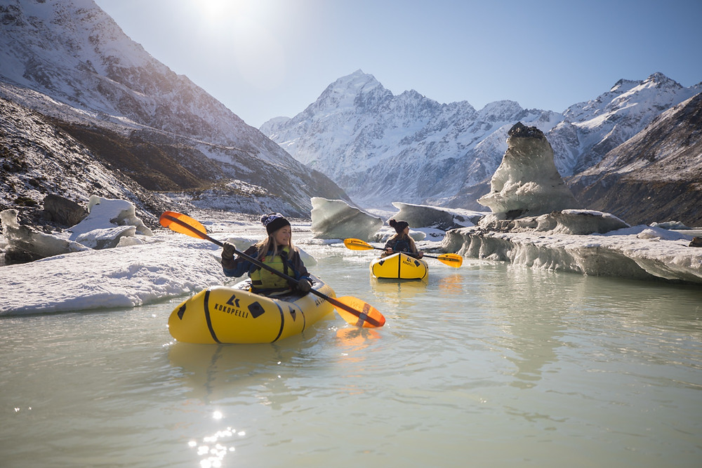 Pack-rafters Exploring Icebergs in Mount Cook National Park