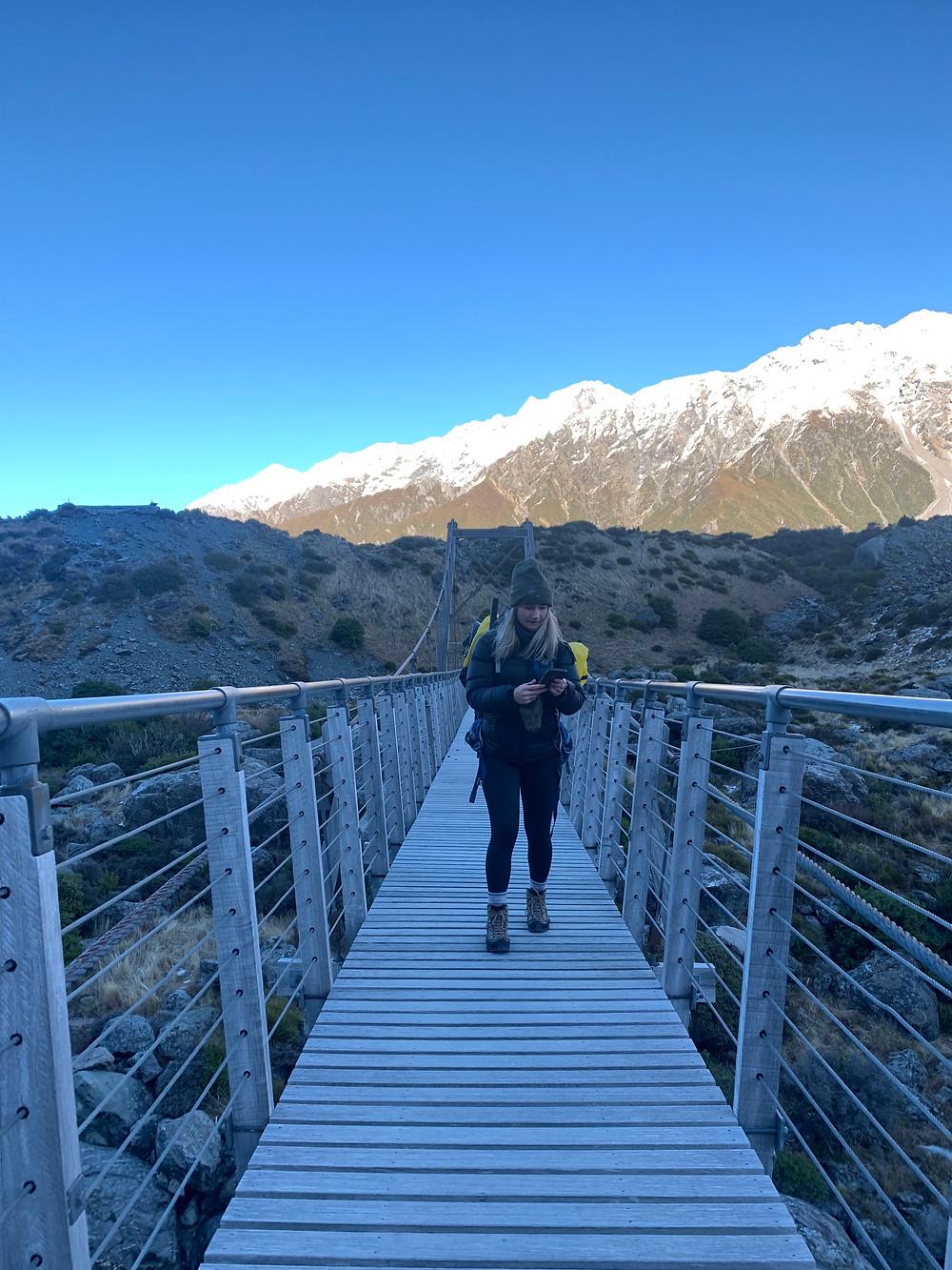 Woman-Crossing-Hooker-Valley-Track-Swing-Bridge