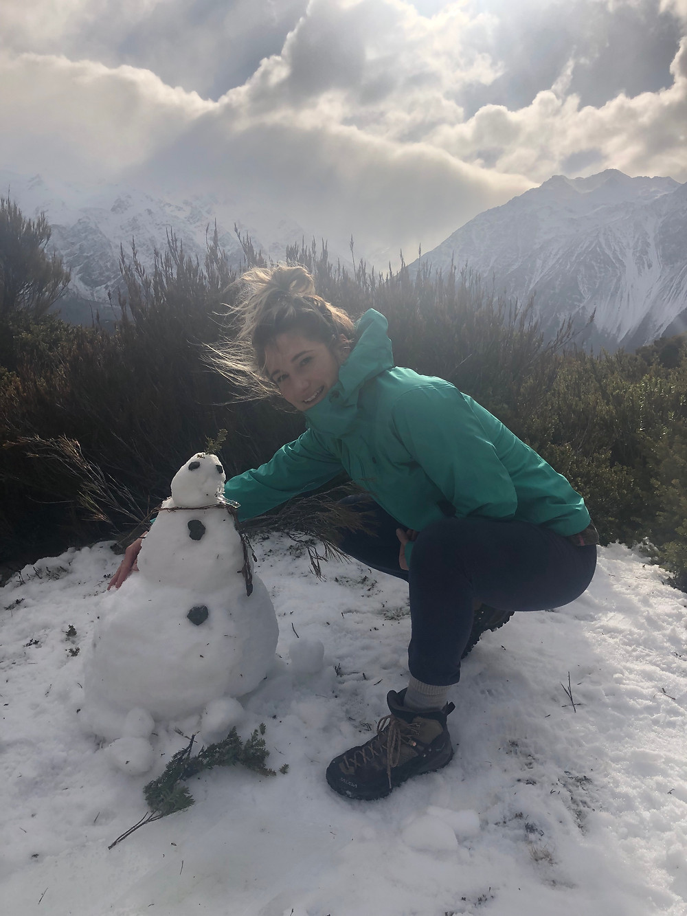 Woman Hiker With Snowman At The Summit Of Red Tarns Hiking Track In Mount Cook