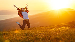 Happy woman jumping and enjoying life in