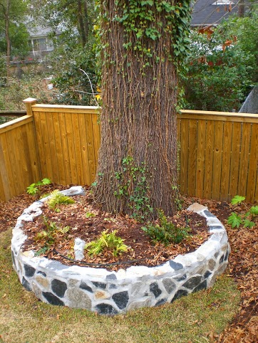 Customized flower bed at base of Oak