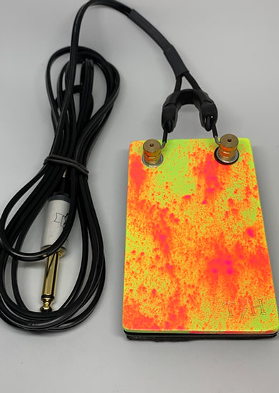 Yellow and orange splatter foot pedal