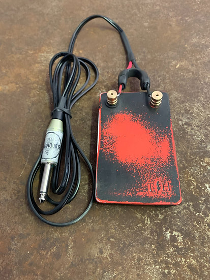 Black and red distressed foot pedal