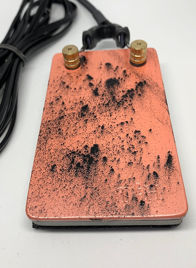 Coral and black splatter foot pedal