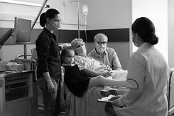 family-visiting-elderly-senior-woman-patient-while-wearing-protective-face-mask_pb.jpg