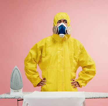 man-in-coveralls-standing-by-ironing-boa