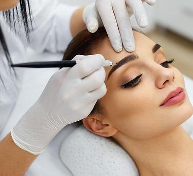 Make-Up. Beautician Hands Doing Eyebrow