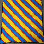 Corner to corner striped stroller blanket