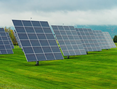 Solar panels placed on a countryside meadow..jpg