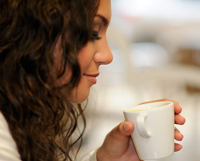 close-up-curly-hair-woman-drinking-cup-coffee.jpg
