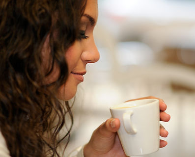 close-up-curly-hair-woman-drinking-cup-c